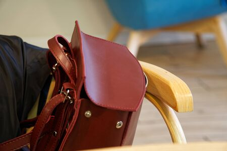 Fashionable beautiful part of leather red backpack. Warm color. Close up