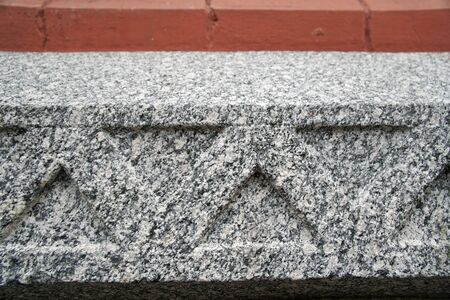 Stone granite wall, ornament on rock wall.