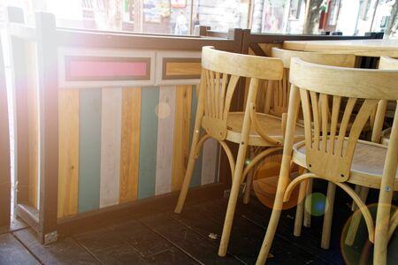Wooden Vintage chairs in cafe, modern cozy interior.