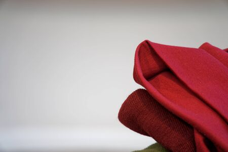 Red scarf on the chair whith white background.