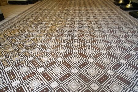 Old checkered floor. Decorative ornamental checkered marble floor. 免版税图像