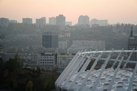 Roof of stadium and cityscape behind on city background. Soccer stadium.