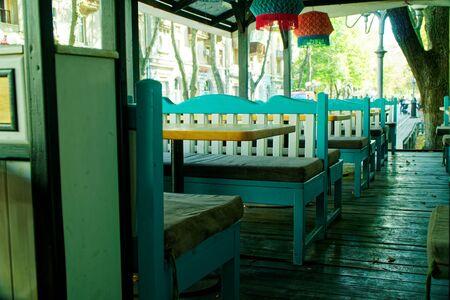 Stylish interior of a cozy cafe, handicraft furniture.