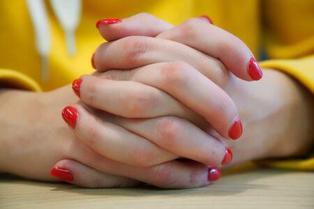 Manicure - Beauty treatment photo of nice manicured woman fingernails with red nail polish 免版税图像