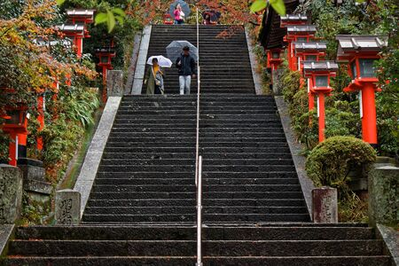 Stairs up to mountain and maple tree in Japan. Stairs in Park at Kinkaku-ji Zen Buddhist Temple in Kyoto, Japan