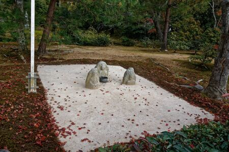 Zen rock garden with raked gravel. relaxing and calming Japanese garden. Nice place for meditation