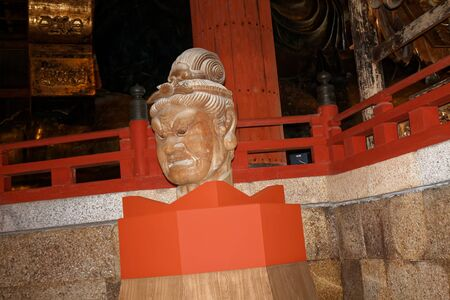 Statue of Bishamonten, an armor-clad god of war or warriors and a punisher of evildoers, in the Daibutsuden hall of Todai-ji Buddhist temple complex in Nara, Japan. Writing translates as