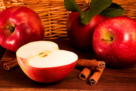 Red apples with cinnamon sticks photo