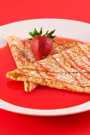 Crepes with strawberry syrup photo