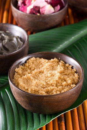 brown sugar: Body scrub with brown sugar crystals and essential oil Stock Photo