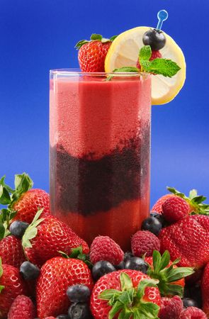 berry smoothie: A glass of layered berry smoothie  (strawberry,raspberry,blueberry)