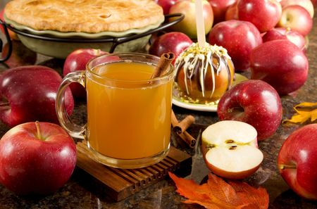 Apple cider, caramel apple and apple pie Stock Photo