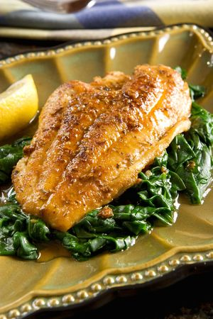 Spiced catfish fillet with spinach photo