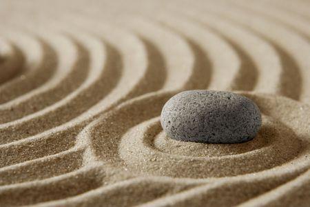 Stone on raked sand Stock Photo - 2355137