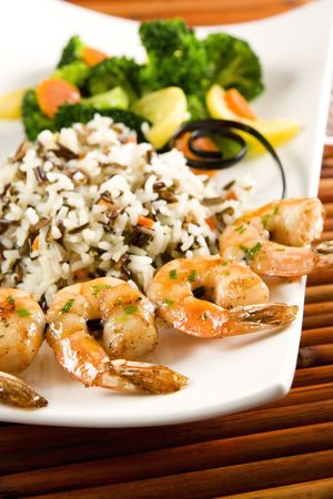 Grilled shrimps, rice and steamed vegetables Stock Photo