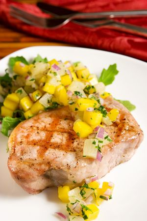 Grilled pork chop with tropical salsa