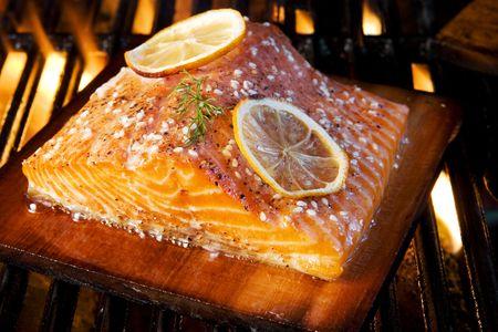Salmon grilling on cedar board
