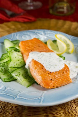 Salmon with dill sauce and cucumber salad Stock Photo