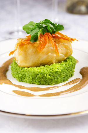 Sea bass served with pea mash and mushroom sauce Stock Photo