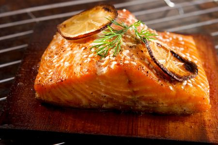 red salmon: Salmon grilled on cedar plank Stock Photo