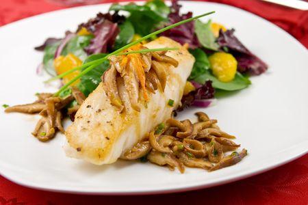 Sea bass with shiitake mushrooms and salad photo