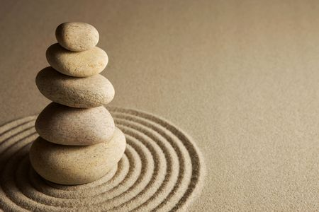 stacked stones: Balancing stones on raked sand