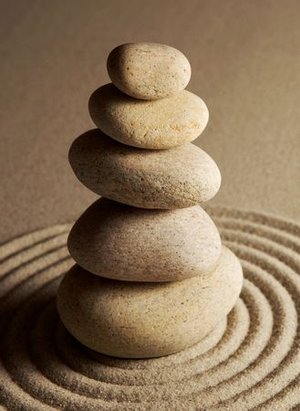 stack rock: Balancing stones on raked sand