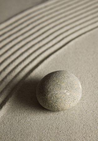 raked: Stone on raked sand  Stock Photo