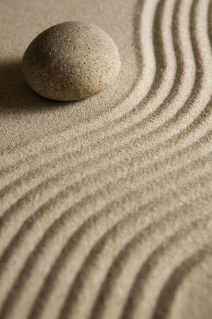 Stone on raked sand  Stock Photo