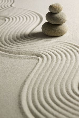 zen stones: Stack of stones on raked sand