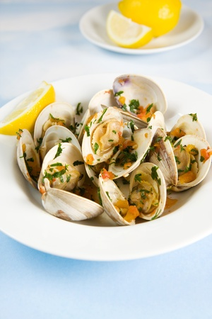 Clams cooked in tomato parsley broth