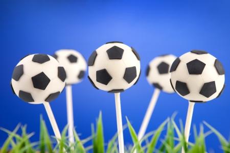 サッカー ボールのケーキの pop 写真素材
