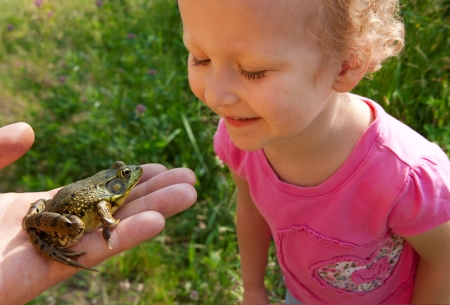 Girl looking at a frog