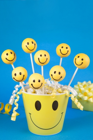 Smiley face cake pops Stock Photo
