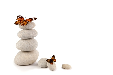 Balanced stones with butterflies