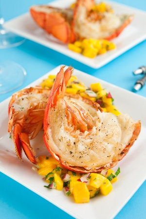 Grilled lobster tails with mango salsa Stock Photo
