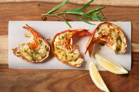 Lobster tails with lemon tarragon butter Stock Photo