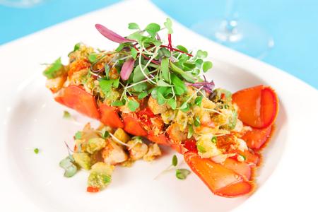Lobster avocado salad in a lobster shell