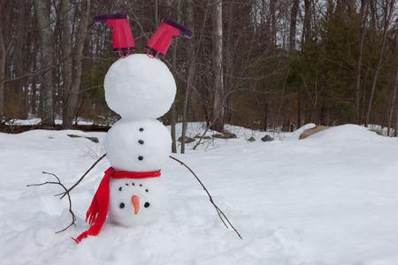 Snowman hoofdstand Stockfoto