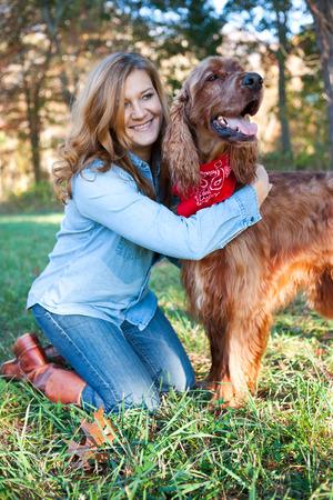 Woman hugging dog Standard-Bild