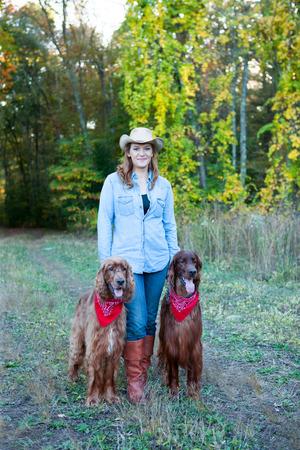 Woman walking dogs Standard-Bild