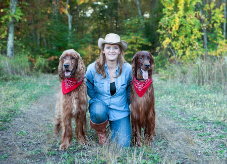 Woman with Irish Setter dogs