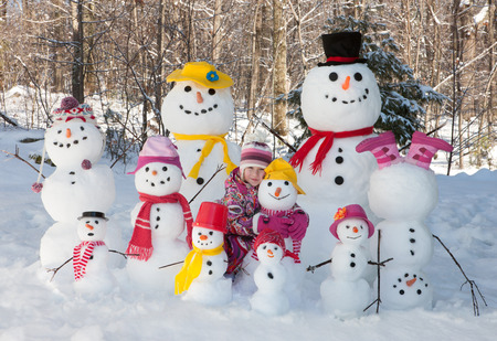 Girl with snowmen
