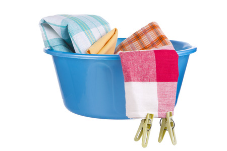 Laundry - blue wash-basin with clean clothes and clothespins photo