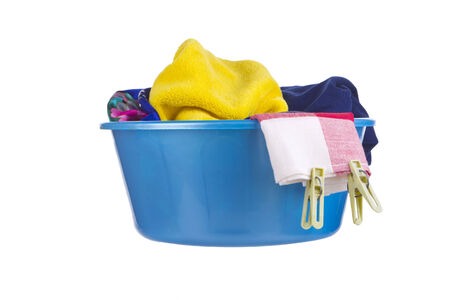 wash basin: Laundry - blue wash-basin with clean clothes and clothespins