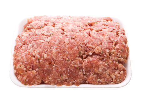 half stuff: Pack of raw minced meat isolated on white Stock Photo