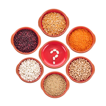 eating questions: Plate with question mark and different types of beans isolated on white Stock Photo