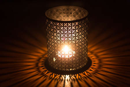 sconce: Candle in sconce with lacing effect and games of shadows