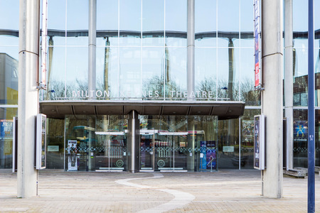 milton: Milton Keynes, England - January 16, 2015: The main entrance of Milton Keynes Theatre, a theatre and entertainment centre, managed by the Ambassador Theatre Group.