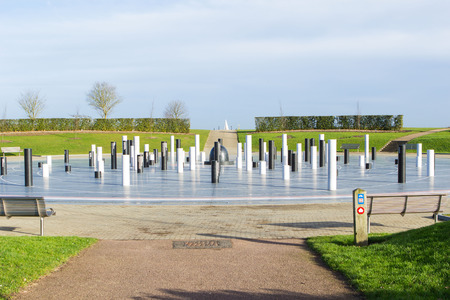 openspace: Milton Keynes, England - January 16, 2015: The MK Rose, created by artist Gordon Young, modern monument with the pillars devoted to different historical events in Campbell Park. Editorial